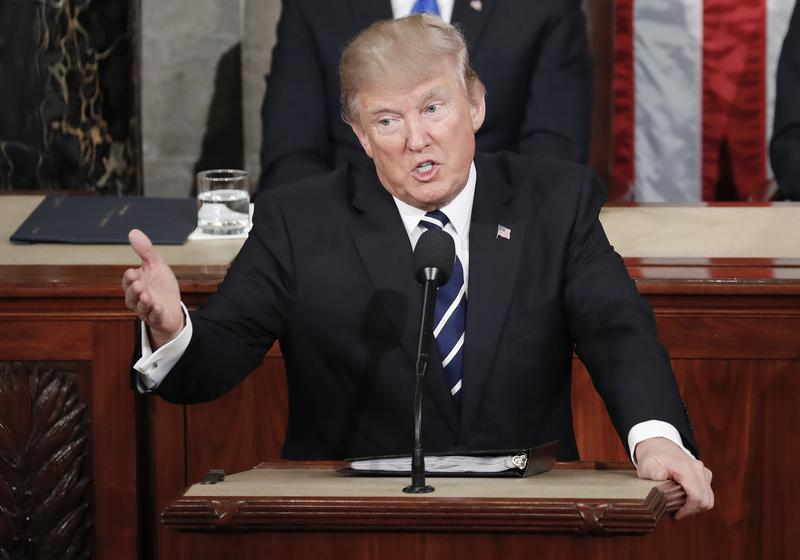 President Donald Trump gestures towards Democrats while addressing a joint session of Congress on Capitol Hill in Washington on Tuesday.