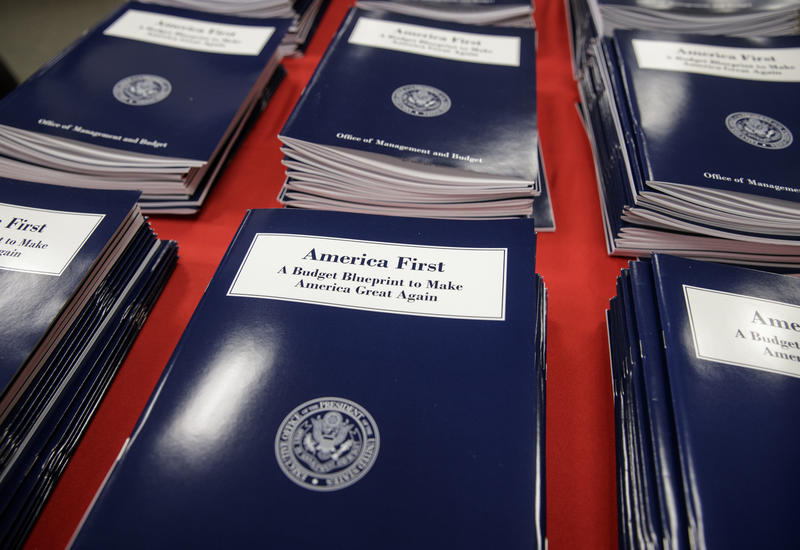Copies of President Donald Trump's first budget are displayed at the Government Printing Office in Washington on Thursday. Trump unveiled a $1.15 trillion budget, a far-reaching overhaul of federal government spending that slashes many domestic programs.