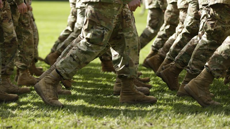 U.S. Army soldiers march in formation during a change of command ceremony.