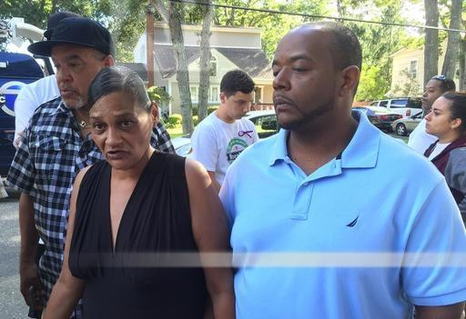 Elizabeth Alvarado and Rob Mickens speak with reporters at the scene where their daughter, Nisa Mickens, was found dead in Brentwood, N.Y., in September. Mickens has just announced that he will be running for a position on the local school board.