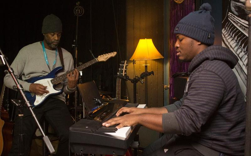 Guitarist and keyboardist play during one set.