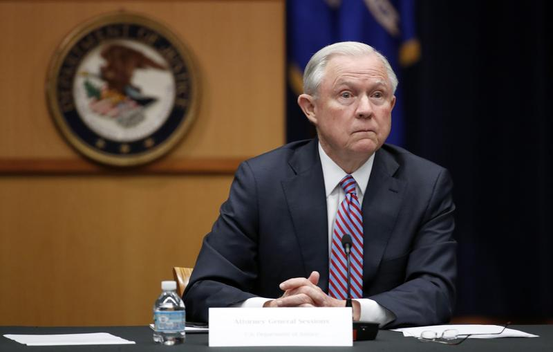 Attorney General Jeff Sessions listens to a reporter's question before a meeting of the Attorney General's Organized Crime Council and Organized Crime Drug Enforcement Task Forces Executive Committee on Tuesday in Washington.