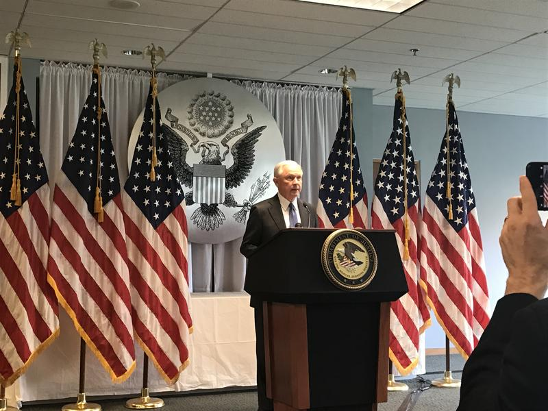 U.S. Attorney General Jeff Sessions speaking at the Central Islip Courthouse on Long Island on Friday. Sessions says that one of the Justice Department's top priorities is to dismantle transnational criminal gangs like MS-13.