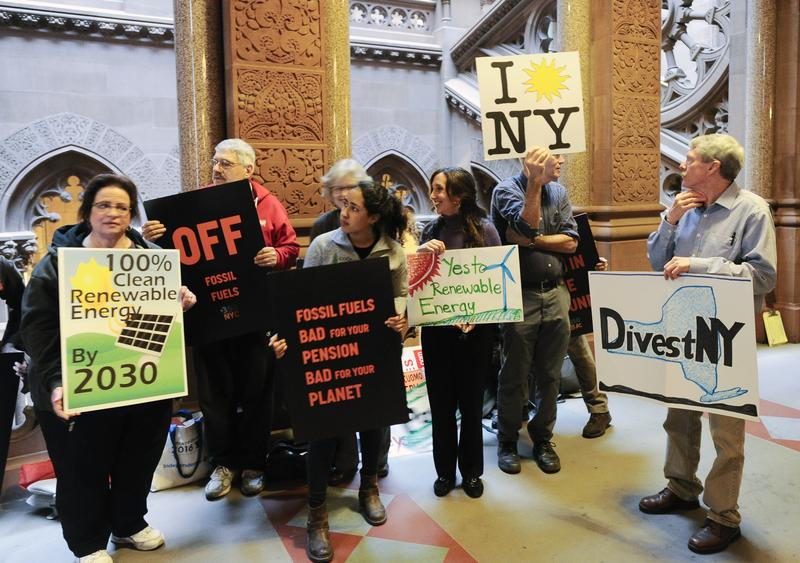 Supporters of a bill to stop New York State from investing state pensions in fossil fuels urge lawmakers to divest New York pension funds from fossil fuels during a news conference at the Capitol on Monday in Albany, N.Y.