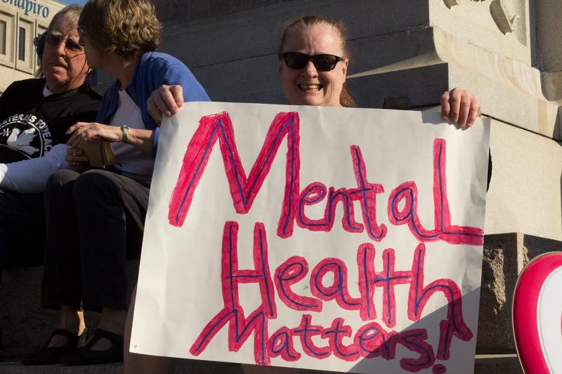 Another demonstrator held a sign alluding to the President's mental state.