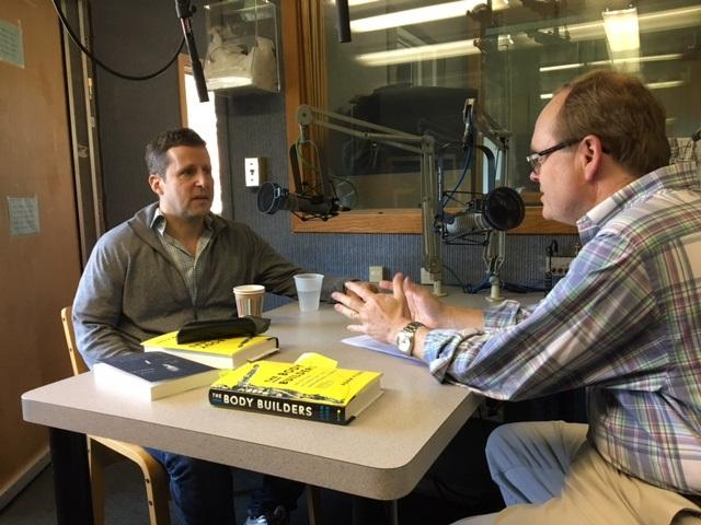 Journalist Adam Piore is interviewed by All Things Considered Host Bill Buchner in the WSHU studios on Friday.