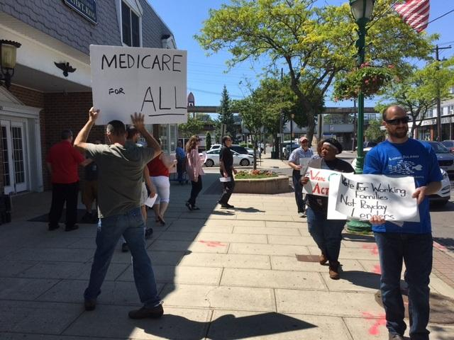 Long Islanders protesting outside Republican legislative offices this week.