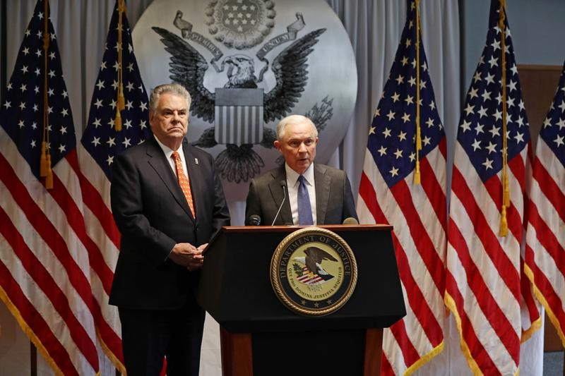 Rep. Peter King, R-N.Y., left, and Attorney General Jeff Sessions, right, speak during a news conference in Central Islip, N.Y., in April.