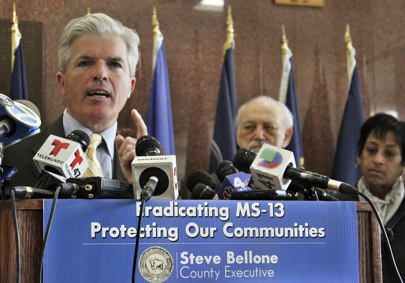Suffolk County Executive Steve Bellone speaks at a press conference in April in Hauppauge, N.Y., where he vowed to take action against the MS-13 street gang. On Wednesday, 17 alleged MS-13 gang members were indicted for two murders on Long Island.