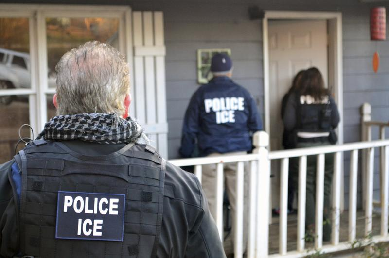 U.S. Immigration and Customs Enforcement agents at a home in Atlanta, during a targeted enforcement operation aimed at immigration fugitives, re-entrants and at-large criminal aliens.