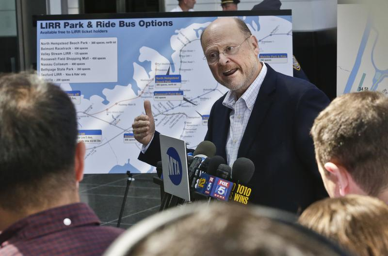 MTA Chairman Joseph Lhota holds a press conference at LIRR Jamaica Station to discuss commuter options, as Amtrak begins emergency repair work at Penn Station in New York in July.