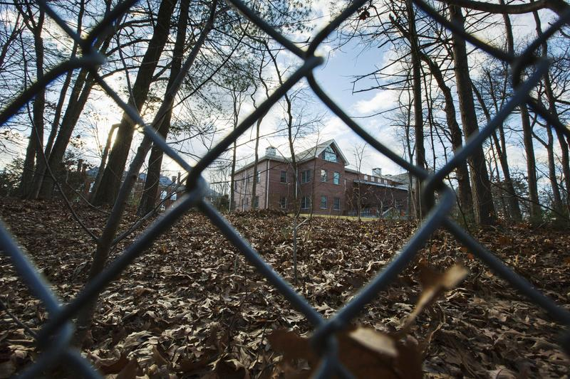 A fence encloses an estate in the village of Upper Brookville in the town of Oyster Bay, N.Y., on Long Island in 2016. In December the Obama administration closed the compound for Russian diplomats, in retaliation for spying and cyber-meddling in the U.S.