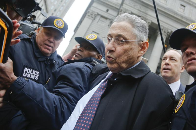 Former Assembly Speaker Sheldon Silver struggles through media to get his cab after he was sentenced to 12 years for corruption in New York in 2016.
