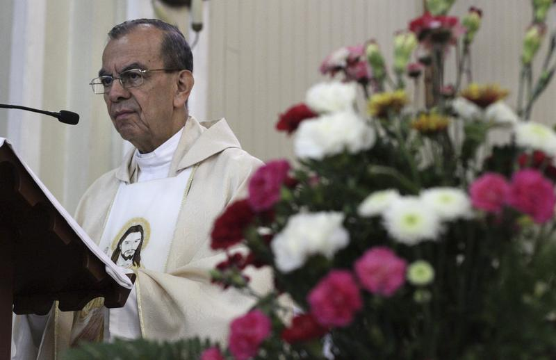 Monsignor Gregorio Rosa Chavez leads a Mass giving thanks for Pope Francis' announcement that he will be elevated to the rank of cardinal, at San Francisco de Asis parish church in San Salvador, El Salvador, in May.