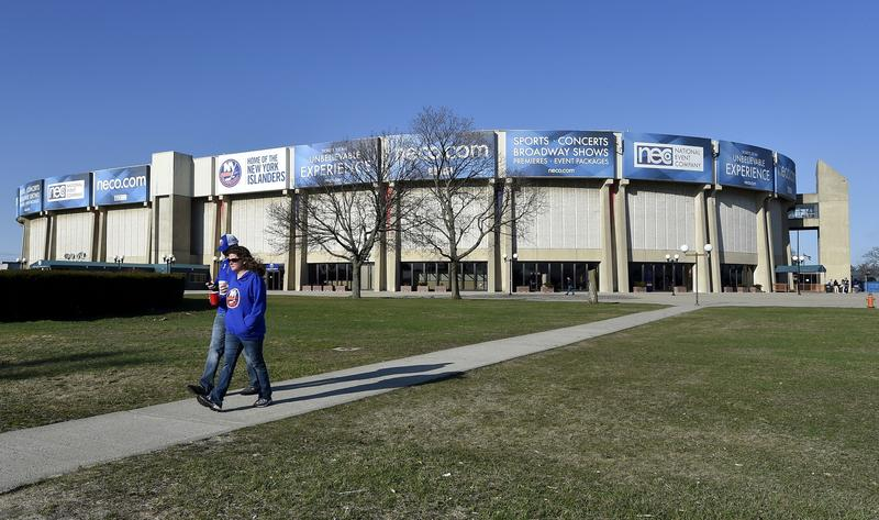 New York Islanders fans walk in front of the Nassau Coliseum before an NHL hockey game against the Columbus Blue Jackets in Uniondale, N.Y., in 2015.