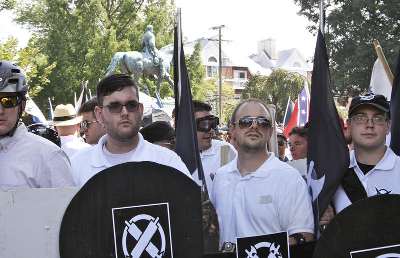 James Alex Fields Jr., second from left, holds a black shield in Charlottesville, Va., where a white supremacist rally took place on Saturday. Fields is accused of plowing a car into a crowd of people protesting the white nationalist rally.