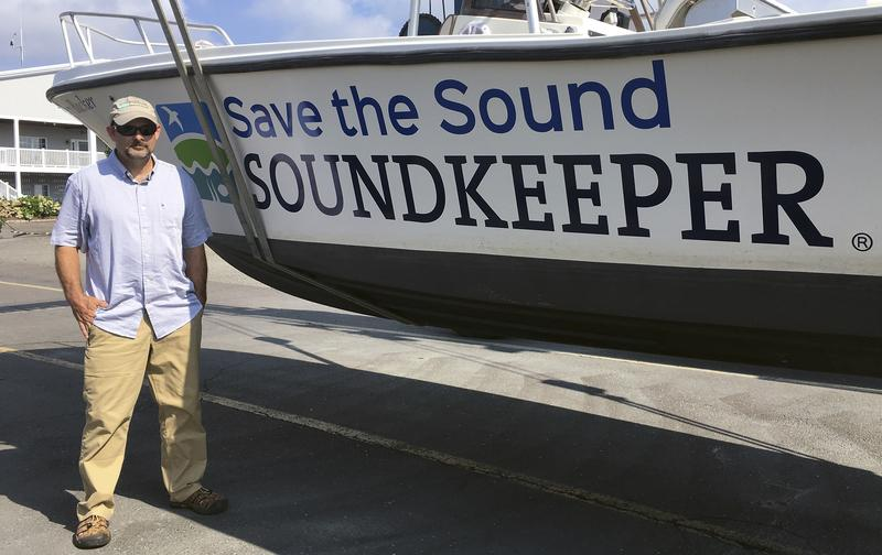 "William Lucey stands beside the vessel ""Soundkeeper"" at Brewers Marina in Stratford, Conn. The 48-year old was recently introduced as the new public watchdog of the 1,300-square-mile estuary that stretches from New York City to eastern Connecticut."