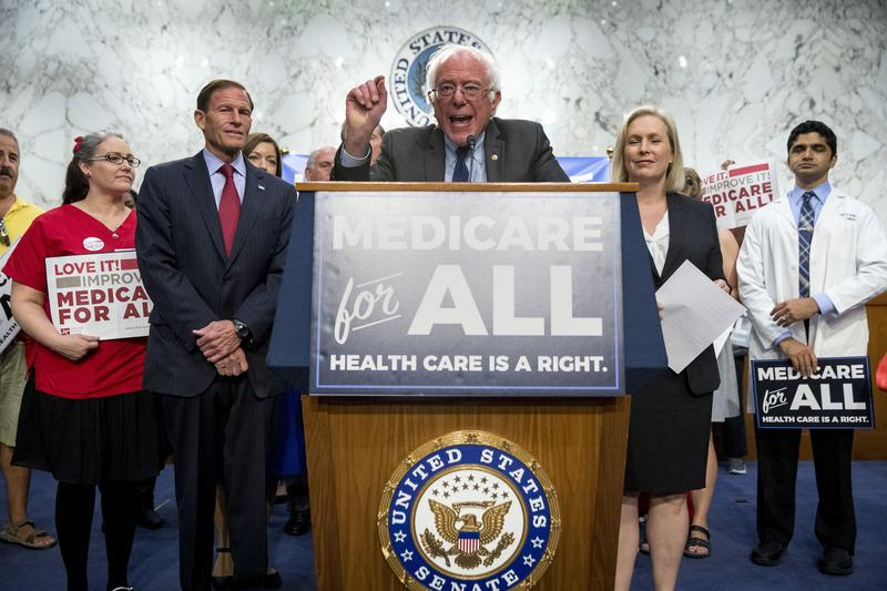 Sen. Bernie Sanders, I-Vt., center, joined by Sen. Richard Blumenthal, D-Conn., center left, Sen. Kirsten Gillibrand, D-N.Y., center right, and supporters, speaks at a news conference on Capitol Hill on Wednesday to unveil Medicare for All legislation.