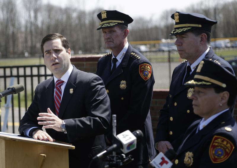 Suffolk County Police Commissioner Timothy Sini, left, speaks to reporters in Central Islip, N.Y., in April after the bodies of four apparent homicide victims were found in a Long Island park.
