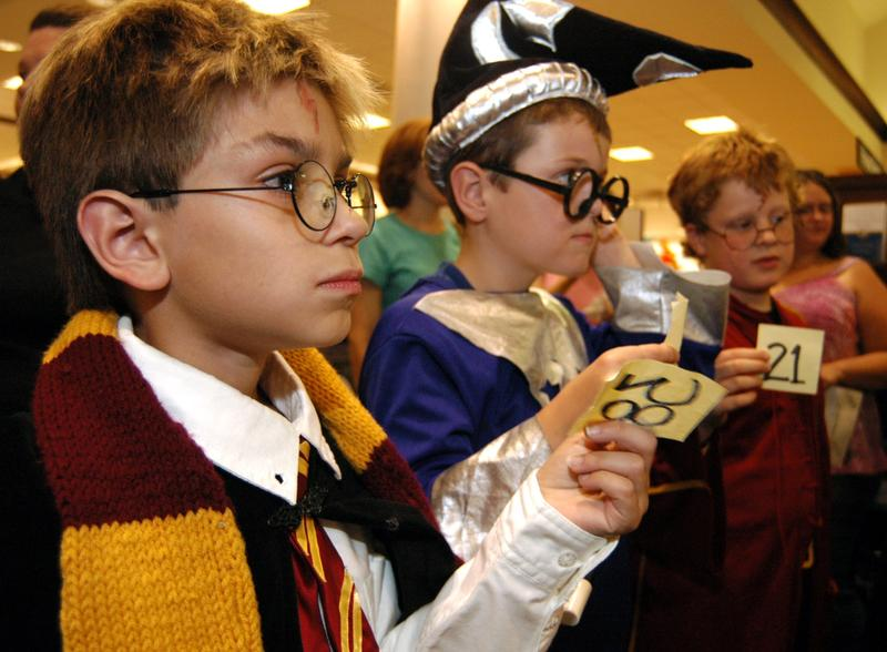 Cody Cloe, 10, Will Rorris, 8, and Cameron Walker, 8, compete in a Harry Potter costume contest during the Midnight Magic Party Friday at a Barnes & Noble store in Columbus, Ohio.