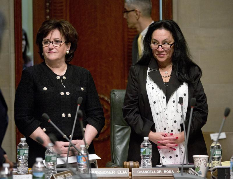 State Education Commissioner MaryEllen Elia, left, and Chancellor Betty Rosa listen to a speaker during a meeting of the Board of Regents in 2016 in Albany, N.Y.