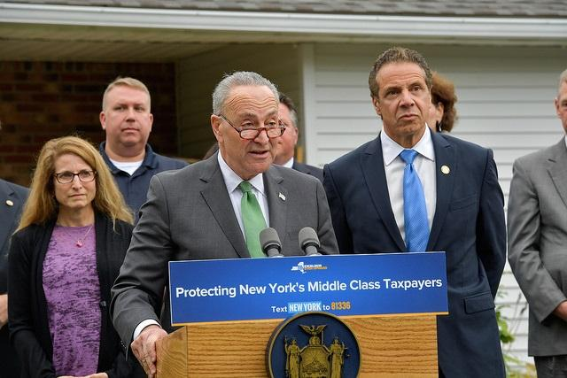 Governor Cuomo and U.S. Senate Minority Leader Chuck Schumer announce a statewide push across congressional districts to urge New York's delegation to oppose the repeal or reduction of state and local tax deductions in Delmar, N.Y., on Monday.
