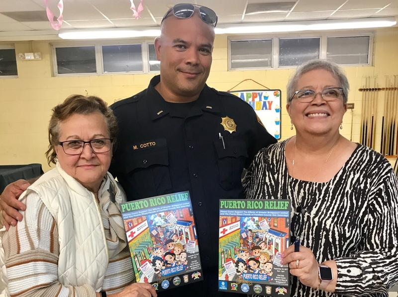 Maria Valle, Bridgeport Police Lieutenant Manuel Cotto, and Rosa Correa at a fundraiser for Hurricane Maria victims, held in Bridgeport in October.