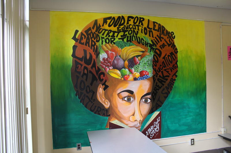 A painted mural in the school's cafeteria.