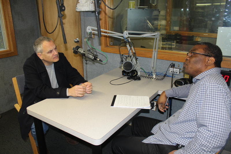 """Westport resident Jarret Liotta, left, speaks with WSHU's Ebong Udoma about his documentary """"Community & Country: A Spirit of Service."""""""
