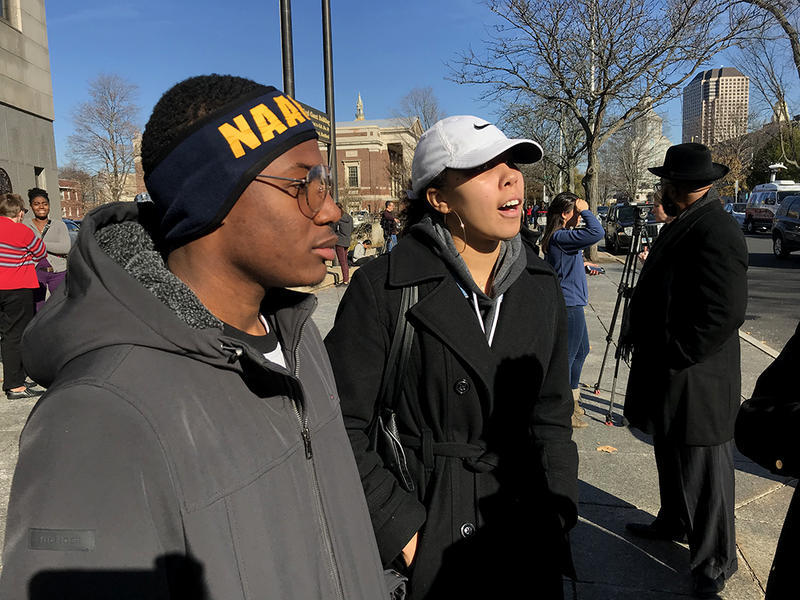 "Jordan Harris, left, and Ajia Coleman, right, members of the University of New Haven chapter of the NAACP, appeared at the Hartford Superior Court Wednesday in support of Chennel ""Jazzy"" Rowe."