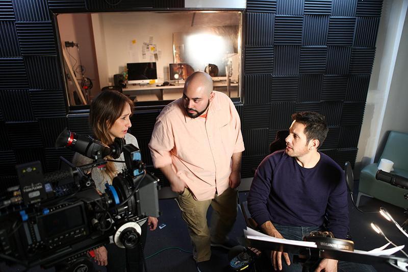 Filmmaker Miguel J. Soliman, center, working with two actors in his film, Desde el Principio.