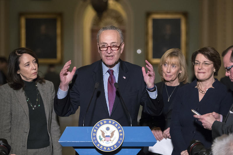 Senate Minority Leader Chuck Schumer, D-N.Y., joined with from left, Sen. Maria Cantwell, D-Wash., Sen. Maggie Hassan, D-N.H., and Sen. Amy Klobuchar, D-Minn., speaks to reporters following a closed-door strategy session on Capitol Hill on Tuesday.