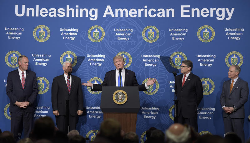 President Donald Trump stands with from left, Interior Secretary Ryan Zinke, Vice President Mike Pence, Energy Secretary Rick Perry and Environmental Protection Agency Administrator Scott Pruitt at the Department of Energy in Washington in June.