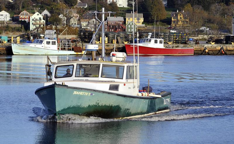 A lobsterman brings his boat to dock in New London, Conn.