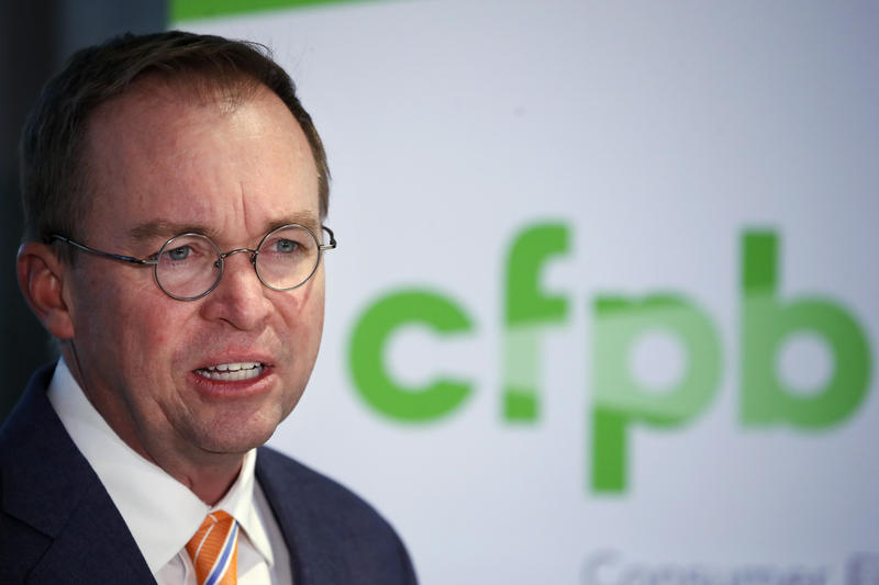 Mick Mulvaney speaks during a news conference after his first day as acting director of the Consumer Financial Protection Bureau in Washington in November.