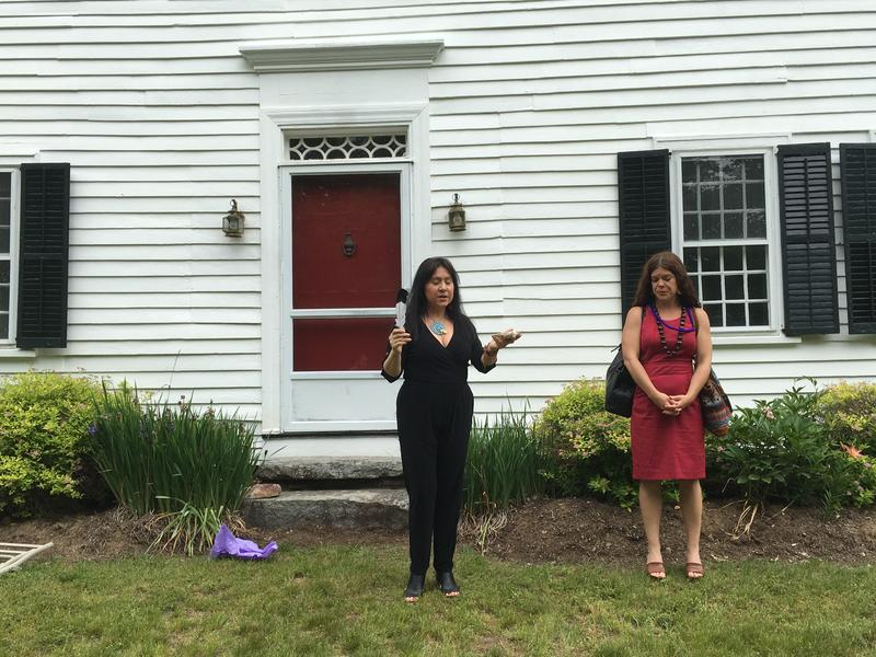 Lawyer and playwright Mary Kathryn Nagel listens to a blessing service outside the schoolmaster's house.