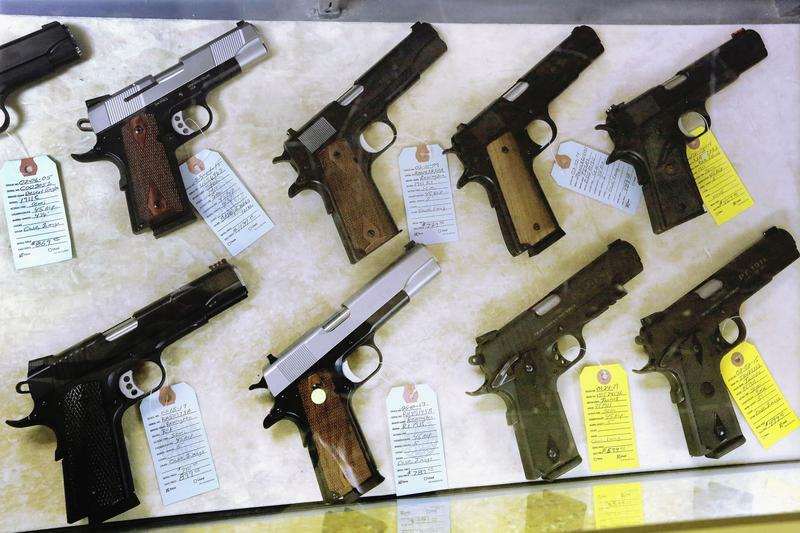 Semi-automatic handguns on display for purchase at Capitol City Arms Supply in Springfield, Ill.