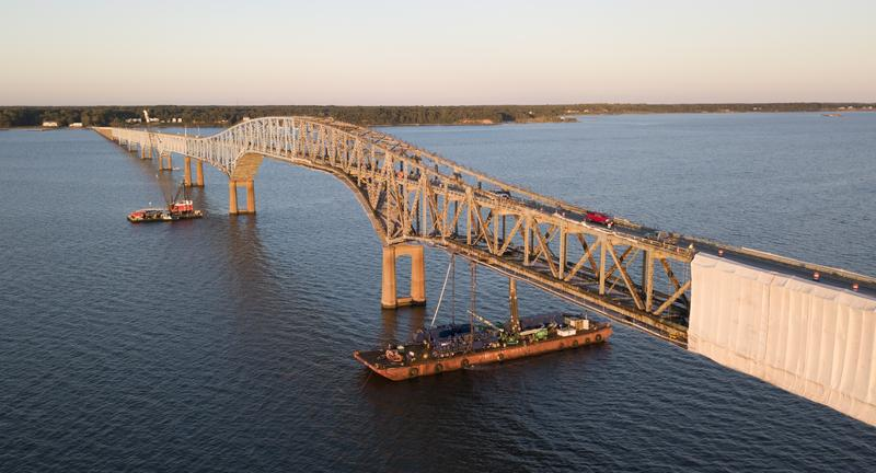 Traffic makes it way across the Robert O. Norris bridge as workers continue maintenance work in Topping, Va., in October.