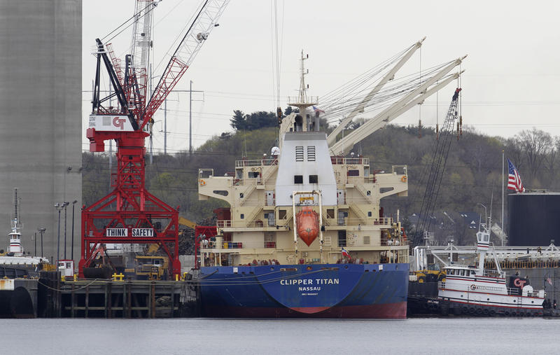 A cargo vessel is seen docked at the Port of New Haven in 2011. The state's maritime industry is fighting battles with nature and politics in a costly effort to dredge sediment from deep water ports to boost shipping and economic development.