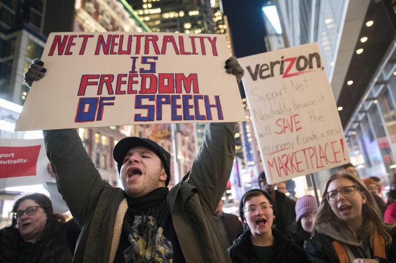 Demonstrators rally in support of net neutrality outside a Verizon store in New York in December.