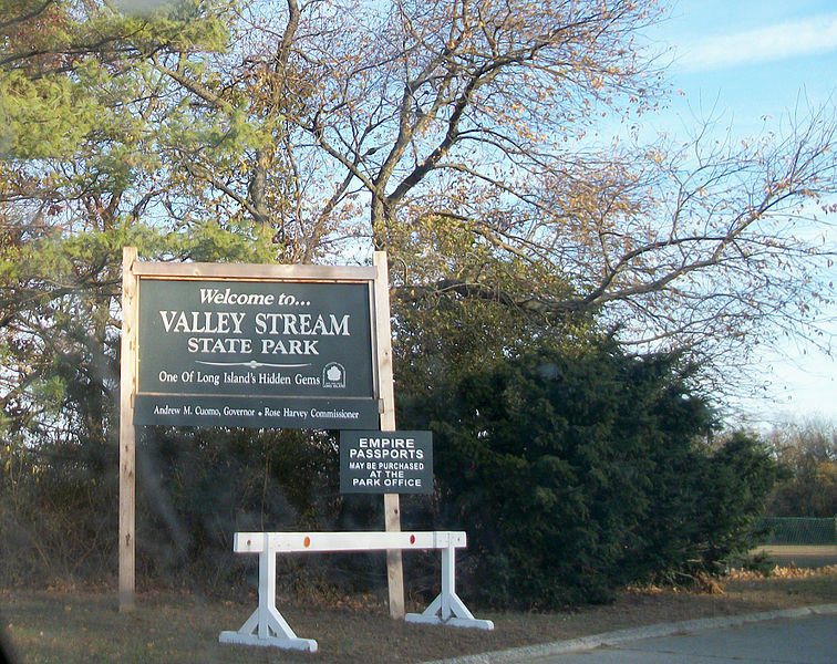 The welcome sign at the entrance for Valley Stream State Park from the Southern State Parkway off-ramp on Long Island.