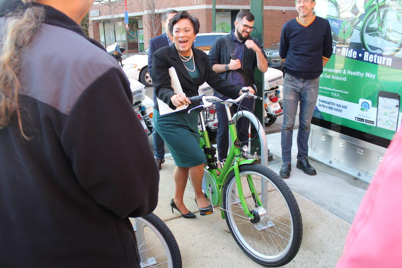 New Haven Mayor Toni Harp rents the first bike from the city's bike sharing program, Bike New Haven, at a launch event on Tuesday.