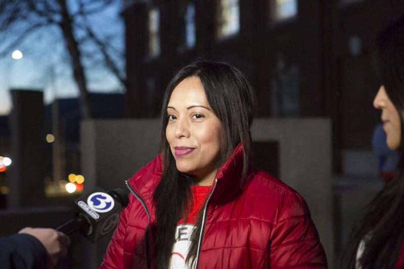 Nelly Cumbicos speaks to reporters outside Meriden City Hall in early Feburary.