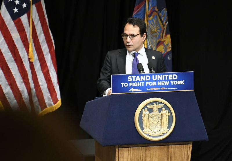 New York State Budget Director Robert Mujica introduces New York Gov. Andrew Cuomo at Cuomo's 2018 executive state budget proposal during a news conference at the Clark Auditorium in Albany, N.Y., in January.