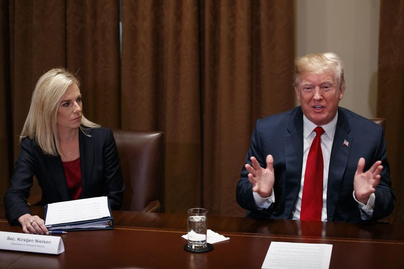 Secretary of Homeland Security Kirstjen Nielsen listens as President Donald Trump speaks during a meeting with law enforcement officials on the MS-13 street gang and border security, in the Cabinet Room of the White House on Tuesday in Washington.