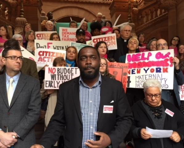 Stanley Fritz of Citizen Action is one of many who spoke against the state budget's priorities at a rally on the Million Dollar Staircase at the Capitol on Wednesday.
