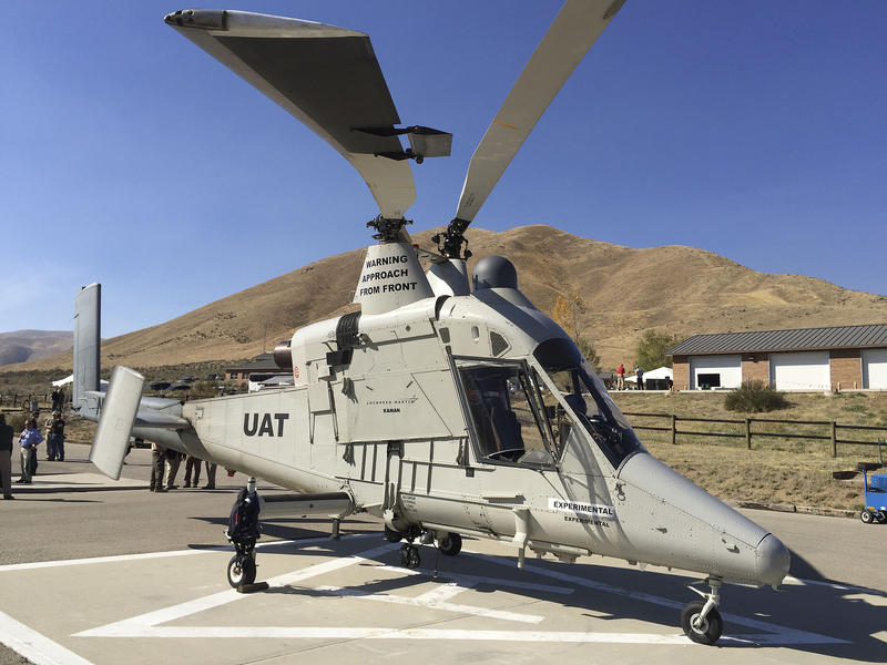 A remote-controlled Lockheed Martin K-MAX sits on a helibase in Boise, Idaho.
