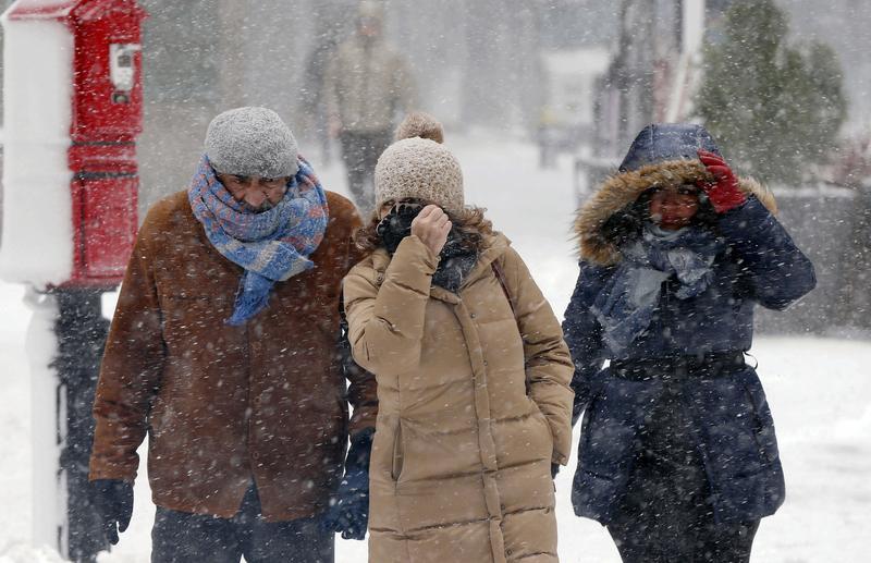 Pedestrians make their way through blowing snow during a snowstorm last week in Boston.
