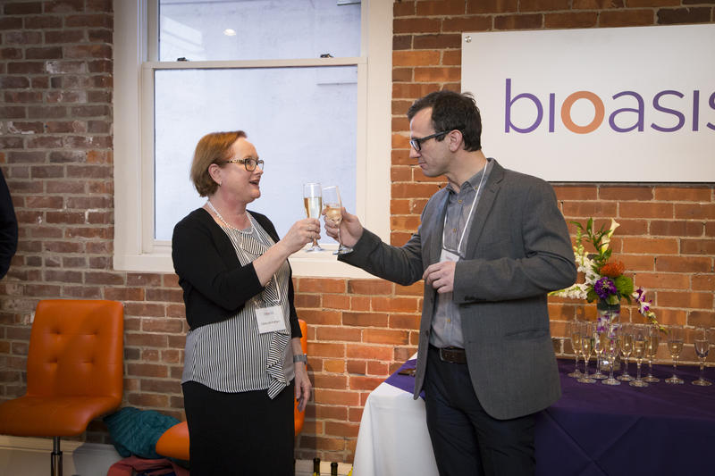 CEO Mark Day of Bioasis Technologies toasts Board Chair Deborah Rathjen at the opening of the Bioasis Technologies office in Guilford, Conn.