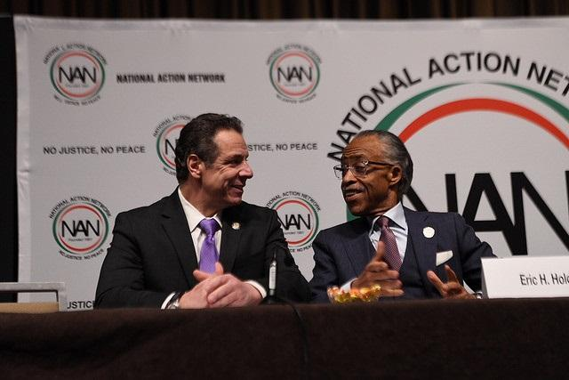 Governor Andrew Cuomo talks with Reverand Al Sharpton at the annual meeting of Sharpton's National Action Network on Wednesday.